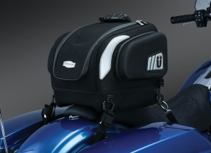 """Perfect day or weekend bag, it is just the right size to store what you need! The contoured bottom and removable base pad provides perfect mounting on both passenger seats or luggage racks! Dims: 14"""" wide X 12"""" deep X 12"""" tall Cubic inches: 1,512 (internal main compartment) Contoured Base with removable pad provides a recessed bottom for coordinating with seats or luggage racks when needed Padded electronics pockets in multiple sizes to fit a variety of devices, including up to a 10"""" tall x 8-1/4"""" wide tablet Internal side elastic pockets and smaller mesh zippered pockets on the lid allow organization to be maintained inside the bag Contoured design provides a streamlined appearance to the back of your bike. Thermoformed side compartments with internal storage pockets Constructed with premium UV-rated, weather-resistant 1200 denier Maxtura® material Custom thermoformed construction with integrated internal support structure for durability and shape retention Premium lined interior with multiple pockets and compartments for easy organization throughout each bag Reflect-A-Light®: Strategically placed custom reflective patches for increased visibility Heavy duty metal-welded D-rings with anti-scratch plastic coating and secured with riveted, sewn box-and-cross premium attachment Protected by weatherproof zippers with glove-friendly and stylish zipper pulls Unique style to follow the contours of virtually any motorcycle and provide secure mounting Includes durable, adjustable mounting straps, ergonomically styled carrying handle, and a rain cover"""