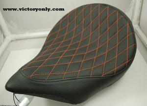 solo seat black orange thread diamond pattern