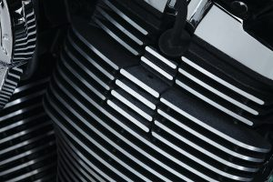 SPARK PLUG FILLERS FINNED VICTORY MOTORCYCLE PICTURE INSTALLED FILLS GAP IN MOTOR WHERE SPARK PLUG INSERTS