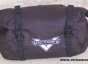Another Victory Only Clearance Item sale! Strap on extra storage in seconds. Add this Saddle Duffel Bag to complement saddlebag, Fits perfect on Victory Only Solo rack for Victory Motorcycle steel frames Vegas, Kingpin, Highball, Gunner Solo rack or trunk cargo capacity. Also a perfect fit for the top of Cross Country, Magnum, Hardball Bikes Saddlebags Use as a backrest bag for any Victory Motorcycle They attach quickly & easily atop saddlebag lid rails or Luggage racks (sold separately). Perfect overnight bag or Luggage carry on bag with Victory Motorcycle Logo Stitched on the front to support your American Made Victory Motorcycle Material: Durable, high-denier nylon Dry seal roll top for quick and easy storage Bags provide quick access to essential cargo, including rain suits, cold weather gear & more Bags provide riders with convenient extra cargo space; can be used to isolate wet gear from other cargo Attach to Saddle Bag to any Lid Rails or Racks 10-lb. weight capacity per bag Sold each (1 left or 1 right or 1 rear)