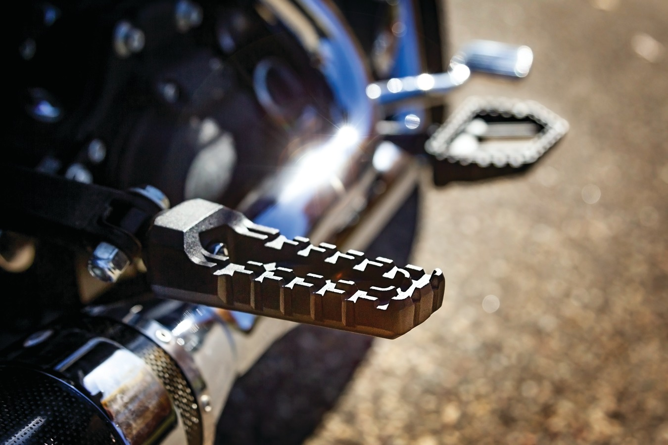 """Born from the dirt. Built to raise hell. Riot's No-BS styling, steadfast stability and traction delivers the confidence to run wild on or off-road. Authentic, industrial MX-styled footpegs measure 4.6"""" long x 1.64"""" wide Requires model-specific splined adapters to allow ideal angle adjustment (adapters sold separately) Serrated toothed top surface for aggressive riding with no-slip traction and control to rip up the streets, tracks or trails Durable cast aluminum construction Available in bead-blasted silver or satin black textured finish that's extremely resilient Tough-looking counterpart to the entire Riot collection of foot controls and grips"""