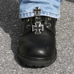The patented Original Ryder Clips boot stirrup boot clips are designed to fit your laced boots. Simply clip the stirrup boot clip to the lace of your boot, then clip to the cuff of your pants. We've designed this with function, style and safety for the motorcycle rider. Laced boot stirrup boot clips come in many different designs that match men's and women's personal style to look cool on their bikes.
