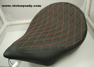 solo seat black orange thread diamond pattern