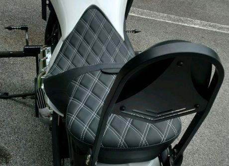 """Solar-reflective leather in the seating area and automotive-grade vinyl on the sides; patented process reduces surface temperature by as much as 25°F for a cooler seat, higher durability and longer life over conventional leather or vinyl Flexible urethane foam interior for maximum comfort 3/16"""" ABS thermoformed seat base with carpeted bottom and rubber bumpers to protect paint Lower position creates better rider position with improved styling Seats can be used with or without driver backrest Seats accept optional EZ Glide II™ backrests PART #s 0822-0133, 0822-0154 or 0822-0189, sold separately Include mounting hardware Made in the U.S.A."""